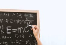 An image of maths equations on a blackboard.